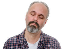 Dozy middle-aged man early in the morning. Dozy bearded middle-aged man early in the morning standing with his head tilted to the side and eyes closed with a Royalty Free Stock Photography