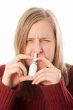 Dépendance de spray nasal - grippe Image libre de droits