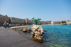 Dplphins statue in Rhodes, Greece stock photo