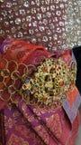 Dräkt på den thailändska traditionella klänningen Fotografering för Bildbyråer