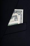 Dräkt som är fick- mycket av dollarräkningar Arkivfoton