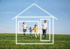dröm- familjhus som kör till Arkivfoton
