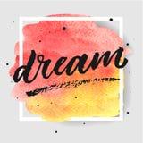 Dröm- hand dragen bokstäver på vattenfärgfärgstänk på vattenfärgfärgstänk i röda och gula färger Arkivbild