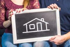Dröm- hus, hem- försäkring, inredesign eller framtidsplanläggning arkivbild