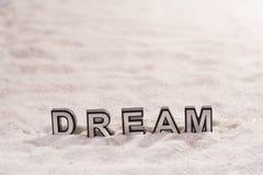 Dröm- ord på vit sand royaltyfria foton