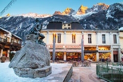 Dr Gabriel Paccard statue, Chamonix, France. Street and mountains view Royalty Free Stock Images