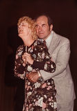 Dr. Henry Heimlich Maneuvering. Dr. Henry Heimlich demonstrates his life-saving technique (the Heimlich maneuver) against choking with a volunteer at a session royalty free stock photography