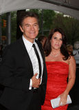 Dr. Mehment Oz and Lisa Oz. Television personality Dr. Mehmet Oz and wife Lisa Oz arrive outdoors on the red carpet at the Time Warner Center in New York City royalty free stock photo