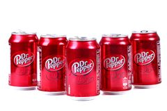 Dr Pepper. Aluminium cans of the Dr Pepper isolated over white background royalty free stock photography