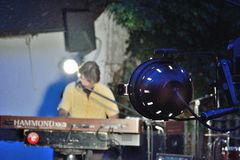 Dr Pickup playing at Vic Sur Cere 15 July 2014. VIC-SUR-CERE, FRANCE, 15 JULY 2014: Close up of a par (light-equipment) and a Unidentified man Performing with Stock Image