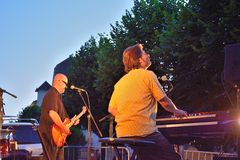 Dr Pickup playing at Vic Sur Cere 15 July 2014. VIC-SUR-CERE, FRANCE, 15 JULY 2014: A synthesiser and Unidentified men Performing with Their band, Dr Pickup Stock Images