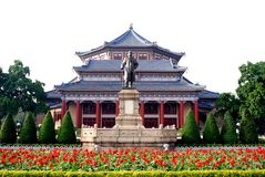 Dr Sun Yat Memorial Hall. High and imperial traditional styled  building. a bronze statue and monument in front of the hall Royalty Free Stock Photos