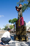 Dr. Sun Yat-sen Statue. Man looking at the flower lei decorated Dr. Sun Yat-sen Statue in Chinatown, Honolulu, Hawaii stock photography