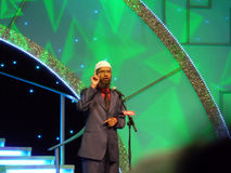 Dr. Zakir Naik Delivering Speech. Dr. Zakir Naik famous Muslim preacher and orator delivering speech to crowd on the topic of Misconceptions about Islam in Royalty Free Stock Images