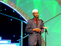 Dr. Zakir Naik Speech. Dr. Zakir Naik famous Muslim preacher and orator delivering speech to crowd on the topic of Misconceptions about Islam in Airport Expo Stock Photography