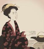详细资料喝日本式茶妇女的dra 图库摄影