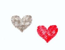 Dra av hjärtor Arkivfoto