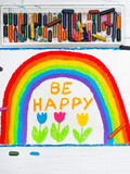 Dra: den härliga regnbågen och ord ÄR LYCKLIGA Royaltyfria Bilder