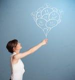 Dra för ballonger för lyckligt kvinnainnehav le Fotografering för Bildbyråer