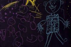 Dra med krita på svart tavla Fotografering för Bildbyråer