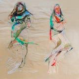 Dra på papper av två bulgarfolkloreklänningar Arkivfoto