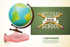 Dra tillbaka till skolabanret, tecknad filmhanden som fångar jordklotet Fotografering för Bildbyråer