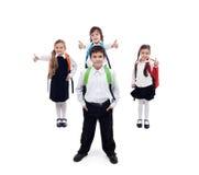 Dra tillbaka till skolabegreppet med lyckligt och coolt ungar Arkivfoton