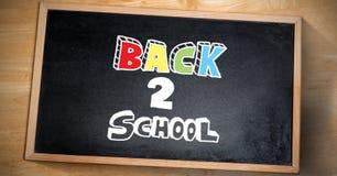 Dra tillbaka till skolahandstil på svart tavla royaltyfri illustrationer