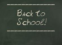 Dra tillbaka till skolan! Inskrift på svart tavla Arkivbild