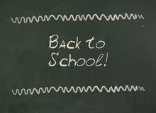Dra tillbaka till skolan! Inskrift på svart tavla Arkivfoto