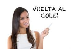 Dra tillbaka till skolan som är skriftlig i spanjor Arkivbild