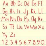 Röd alfabetuppsättning Arkivbild