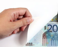 Draaiend wit pagina en geld Royalty-vrije Stock Foto