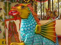 Draak op een carrousel Royalty-vrije Stock Afbeeldingen