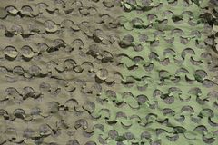 Camo background. A drab background of army camouflage netting Royalty Free Stock Images