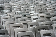 Drab chairs. Many gray, drab chairs arranged outside for an event stock photos