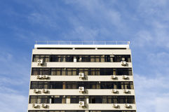 Drab old building. Drab, boring old building with air conditioning units in windows Stock Photos