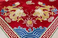 Drachebild auf dem Teppich Stockbilder