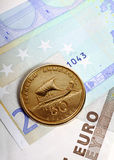 Drachma coin on euro notes Royalty Free Stock Photo