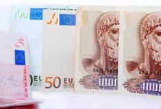 Drachmas and Euros Stock Photography