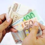 Drachmas and Euros Stock Photos