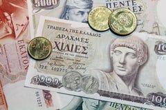 Drachme, bankbiljetten en muntstukken Stock Foto's