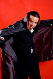 Dracula. Man in his cape with scary look stock photography