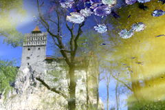 Dracula`s castle in Romania with calm water reflection Royalty Free Stock Photography