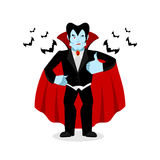 Dracula Thumbs up shows well. Vampire winks. Sign all right. Jol Royalty Free Stock Photos