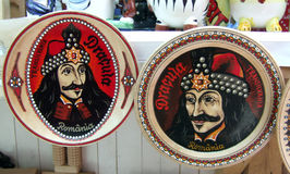 Dracula or Vlad Tepes?. Plates displayed on a market, having imprinted the Walachian king Vlad Tepes (The Impaler), whose image has been asociated with Dracula Royalty Free Stock Photo