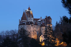 Travel Romania: Bran Castle. Late blue hour found me gazing at Romanias most famous castle from the hill in the vicinity. You probably heard of its most famous royalty free stock photos