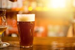 Draft beer on bar. At Brew Pub - with room for text. Perfect evening concept. Weekend party stock photo