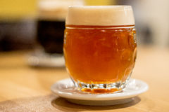Draft Beer with ceramic beer mat Royalty Free Stock Photo