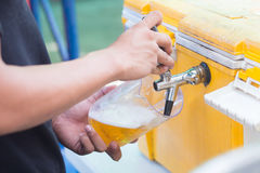 Draft beer dispenser. In party or pub Stock Photography